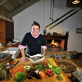 Renowned Chef Miguel Maestre preparing trout at Moonbah River hut