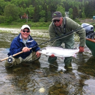 RRL guest Scott, with a bright 32 lb hen. Scott's taken many nice salmon during his trips to the lodge.